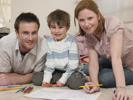 35 40 years old: Parents on Floor Coloring With Son