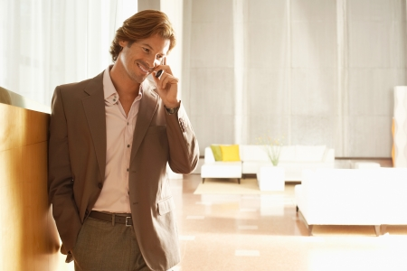 Businessman using mobile phone indoors Stock Photo - 18884513