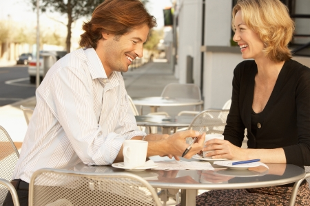 Couple smiling at outdoor cafe Stock Photo - 18884697
