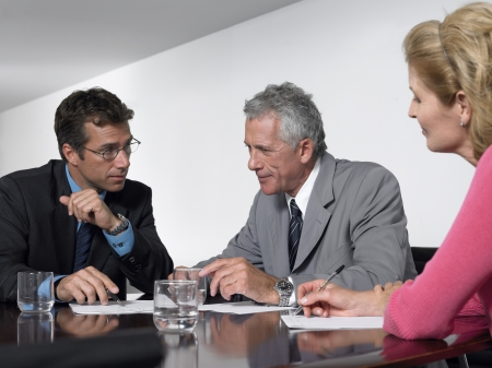 dictating: Three business colleagues in conference meeting