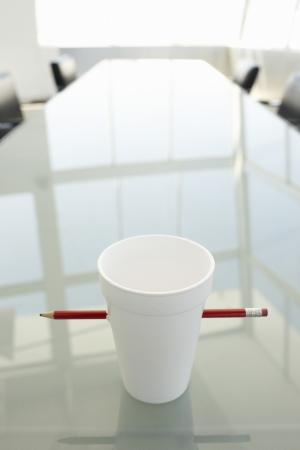 Empty Disposable Cup and Pencil on Conference Table Stock Photo - 18884435