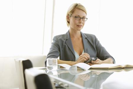 fortysomething: Businesswoman Using PDA