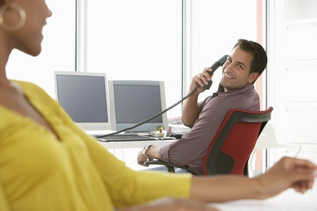 Business people in office smiling Stock Photo - 18884500