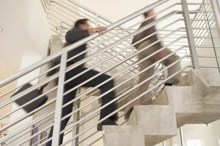 climbing stairs: Businessmen climbing stairwell low angle view