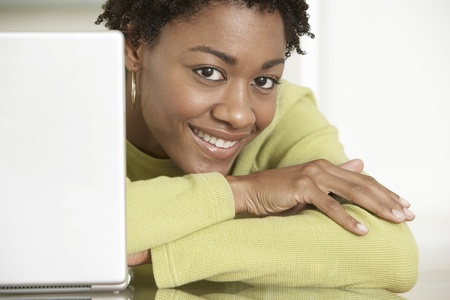 business roles: Smiling Woman Using Laptop LANG_EVOIMAGES