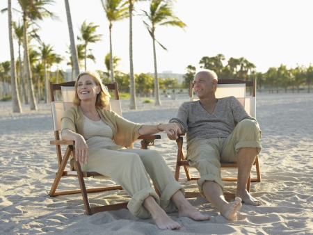 late fifties: Senior Couple on Beach LANG_EVOIMAGES