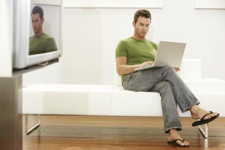Man Using Laptop Stock Photo - 18884531