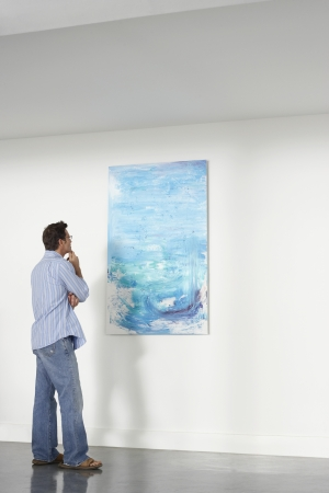 Man looking observing in art gallery Stock Photo - 19075567