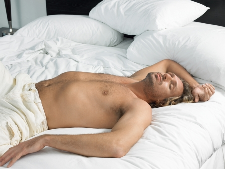 partially nude: Partially nude man asleep on bed LANG_EVOIMAGES