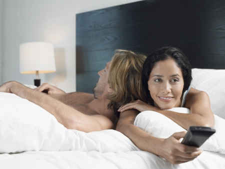Couple Relaxing on Bed Stock Photo - 18884107