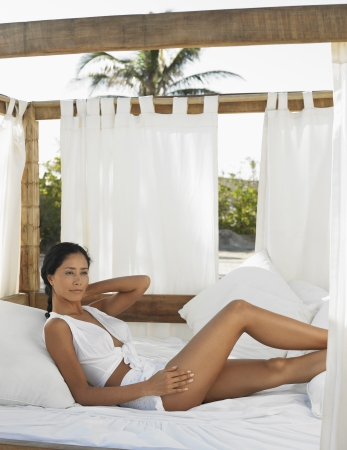 Woman Relaxing in Outdoor Bed Stock Photo