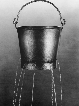 water hole: Water poring through holes in bucket (b&w) LANG_EVOIMAGES