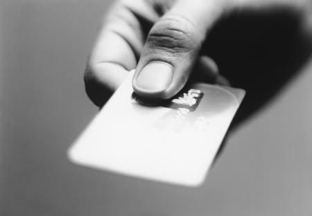 bankcard: Hand Holding Credit Card LANG_EVOIMAGES