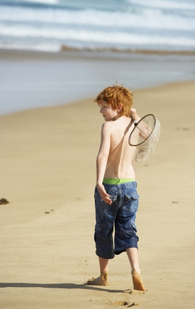 partially nude: Boy Playing on Beach LANG_EVOIMAGES