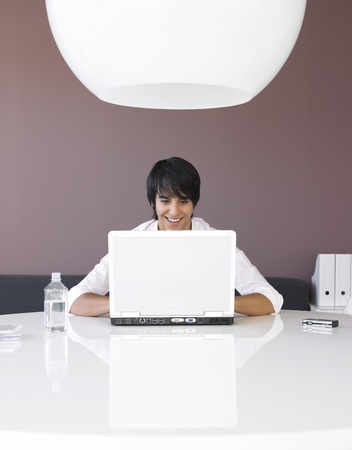 Man Using Laptop at White Table Stock Photo - 19075658