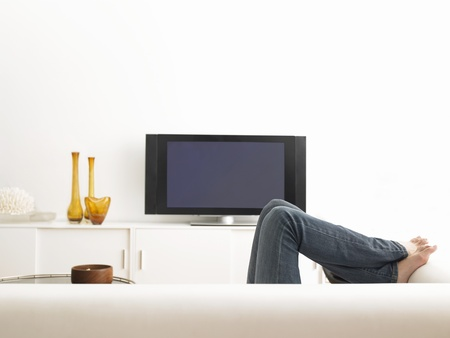 Woman lying on sofa low section Stock Photo - 19075691