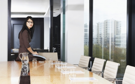 mundane: Businesswoman Sitting in Conference Room LANG_EVOIMAGES