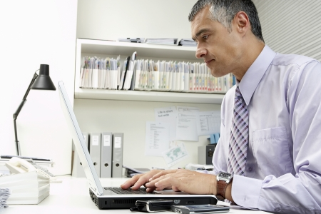 hooked up: Businessman Working on a Laptop