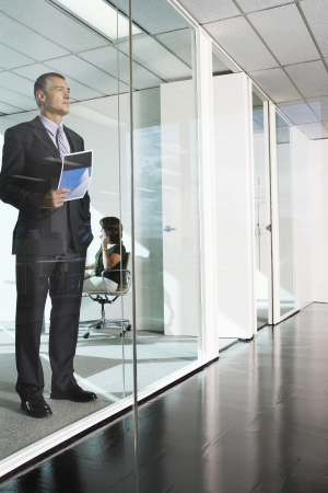 late forties: Businessman Standing in an Office