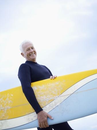 only senior men: Senior Man with Surfboard