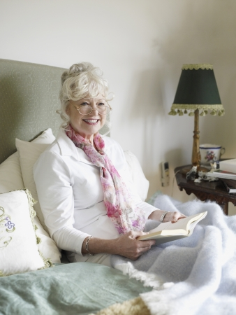 Senior Woman Relaxing with a Book Stock Photo - 18886012