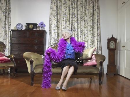 Senior Woman Sitting on Love Seat Stock Photo - 18886792