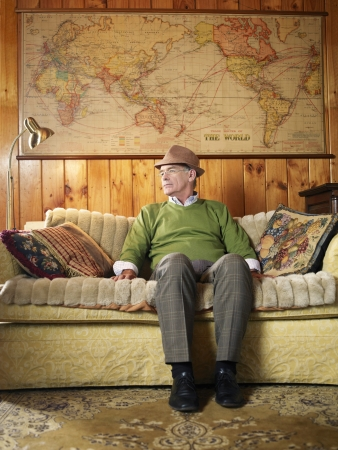 Senior Man Sitting on Couch Stock Photo - 18886768