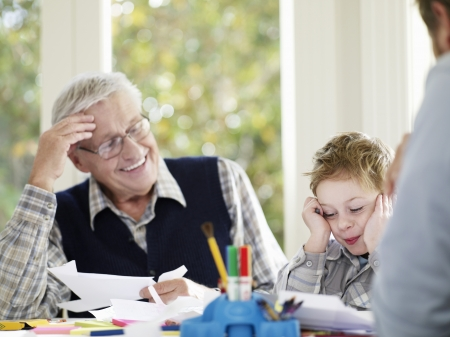 multi generational: Boy (3-4) laughing with father and grandfather in house LANG_EVOIMAGES