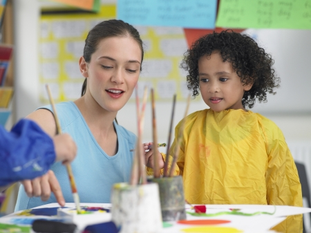 ethnic mixes: Elementary Student and Teacher in Art Class