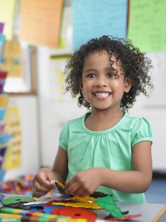 School Girl Assembling Puzzle