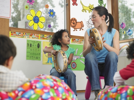 early childhood: Teacher Demonstrating Tambourine Playing
