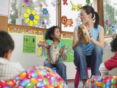 educator: Teacher Demonstrating Tambourine Playing