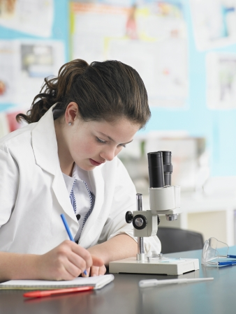 exerting: High School Student in Chemistry Class LANG_EVOIMAGES