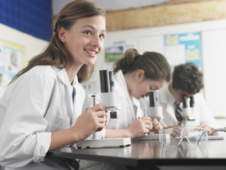 preadolescence: High School Students Using Microscopes