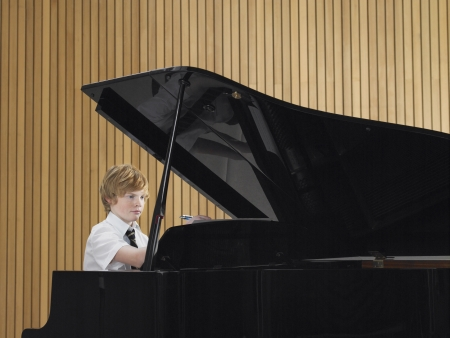 grand piano: High School Student Practicing Piano