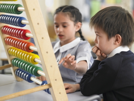abaci: Schoolkids Using an Abacus LANG_EVOIMAGES