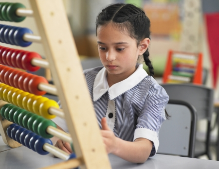 abaci: Schoolgirl Using an Abacus LANG_EVOIMAGES