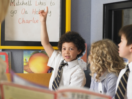 raise your hand: Schoolboy with Hand Raised