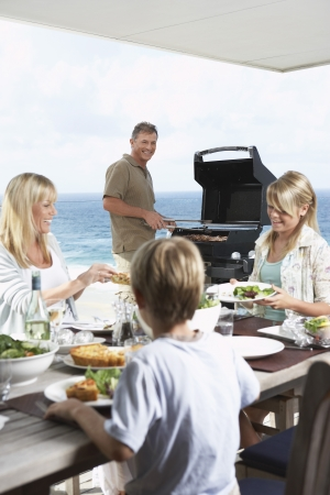 late forties: Family Having Barbecue