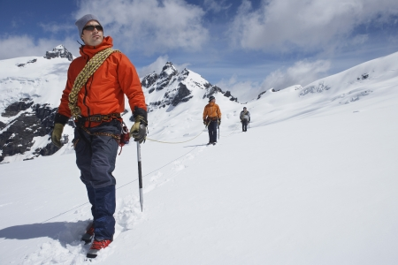 snow covered mountain: Three Mountaineers in Mountain Landscape