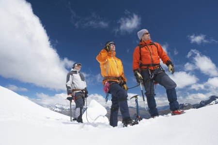 Mountain Climbers Using Satellite Telephone Stock Photo - 18885646