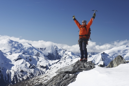 arms raised: Excited Mountaineer Standing on Apex