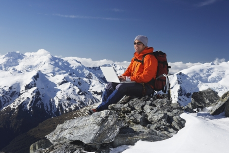 Mountaineer Using Laptop