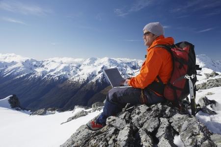 succeeding: Mountaineer Using Laptop