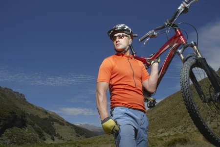 mountainbiking: Mountainbiker Carrying Bike