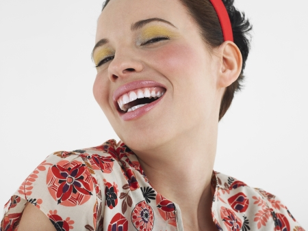 Woman laughing head and shoulders in studio Stock Photo - 19213619