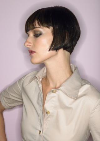 bobbed: Woman with bobbed hair profile in studio