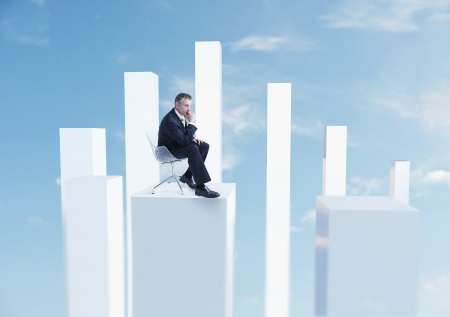 fortysomething: Businessman Sitting on Graph