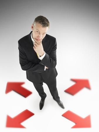 opting: Businessman Deciding on Direction