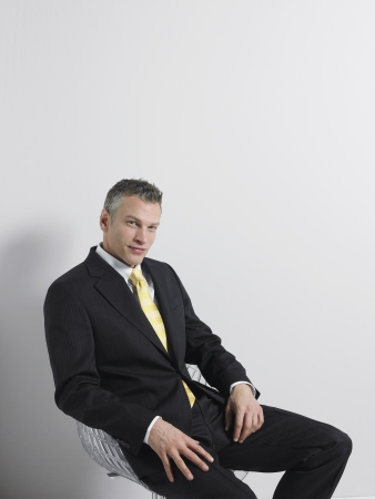 business roles: Businessman Sitting in Swivel Chair